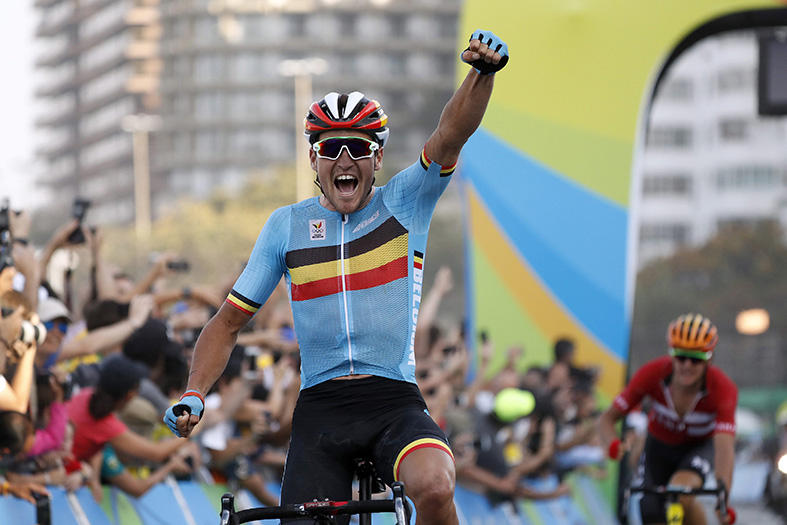 epa05459411 Greg van Avermaet of Belgium celebrates winning the men's Road Cycling race of the Rio 2016 Olympic Games in Rio de Janeiro, Brazil, 06 August 2016.  EPA/JAVIER ETXEZARRETA