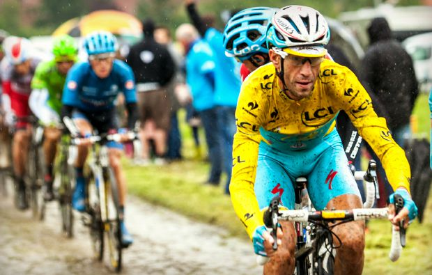 Ennevelin, France - July 09,2014: The Italian cyclist Vincenzo Nibali ( Team Astana) wearin the Yellow Jersey on a dirty cobbled road during the stage 5 of Le Tour de France 2014. Nibali won this edition of competition.
