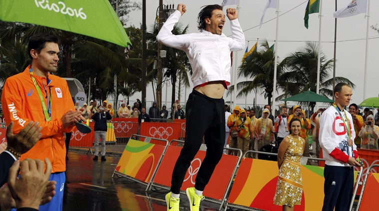 2016 Rio Olympics - Cycling Road - Victory Ceremony - Men's Individual Time Trial Victory Ceremony - Pontal - Rio de Janeiro, Brazil - 10/08/2016. Tom Dumoulin (NED) of Netherlands, Fabian Cancellara (SUI) of Switzerland and Chris Froome (GBR) of United Kingdom on podium. REUTERS/Eric Gaillard FOR EDITORIAL USE ONLY. NOT FOR SALE FOR MARKETING OR ADVERTISING CAMPAIGNS.