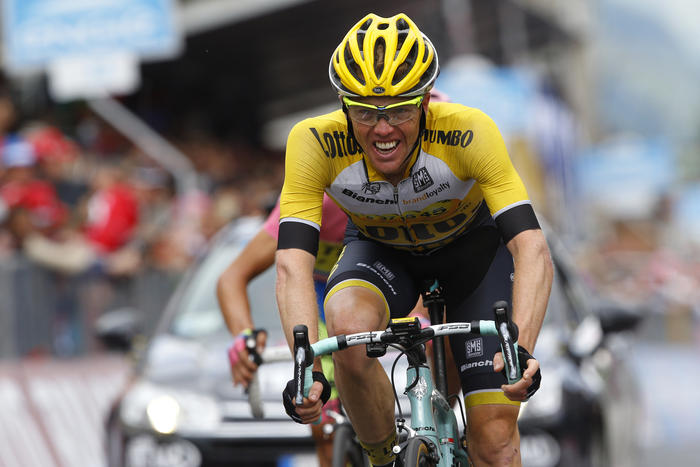 Dutch rider Steven Kruijswijk (Lotto NL- Jumbo) crosses 2nd the finish line of the 16th stage of the 98th Giro d'Italia, Tour of Italy, cycling race between Pinzolo and Aprica on May 26, 2015 in Aprica. Spaniard Alberto Contador took a massive step towards his second Giro d'Italia triumph after increasing his overall lead on Fabio Aru after an epic 16th stage won by fellow Spaniard Mikel Landa today. Landa came over the finish line in 5hr 02min 51sec with Contador settling for third place at 38sec behind on the wheel of Dutchman Steven Kruijswijk. AFP PHOTO / LUK BENIES (Photo credit should read LUK BENIES/AFP/Getty Images)
